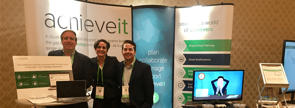 AchieveIt team members present together at a conference